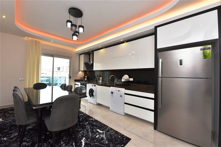 Квартира 3+1 с отдельной кухней в районе Махмутлар - Фото 13