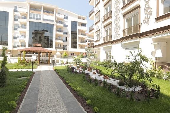 Квартиры 1+1 и 3+1 с газом в районе Хурма Коньяалты Анталия - Фото 2