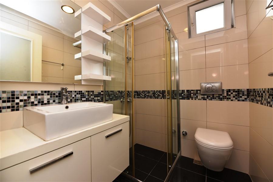 Меблированные апартаменты 2+1 у моря в Конаклы - Фото 33
