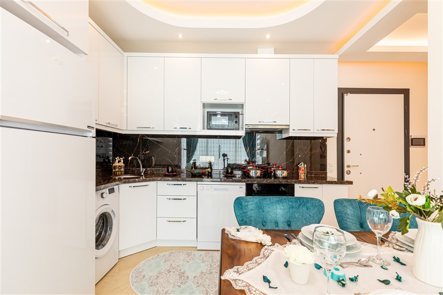 Квартира планировкой 1+1 в Махмутларе - Фото 7