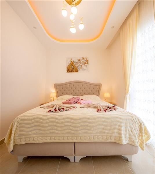 Квартира планировкой 1+1 в Махмутларе - Фото 11