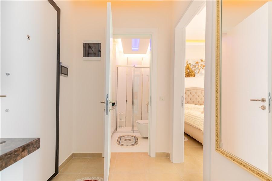 Квартира планировкой 1+1 в Махмутларе - Фото 13