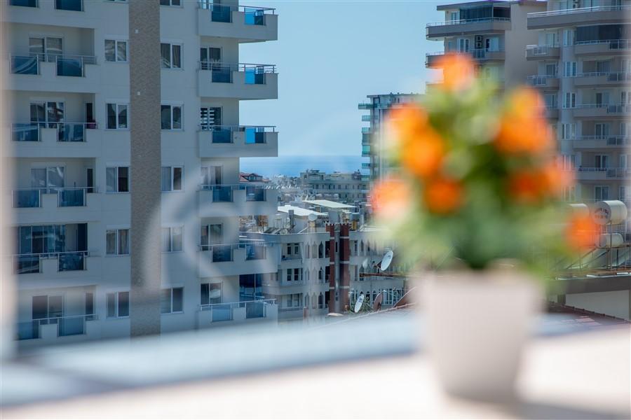 Квартира планировкой 1+1 в Махмутларе - Фото 16