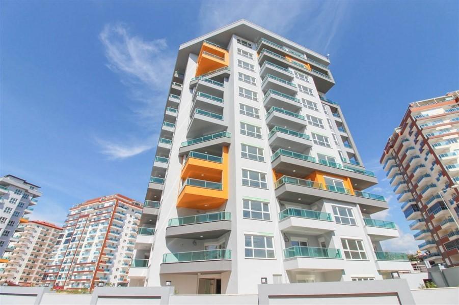 Меблированные апартаменты 1+1 в районе Махмутлар - Фото 1