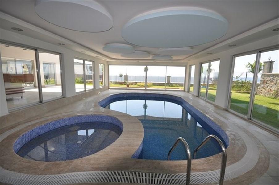 Меблированные апартаменты 2+1 у моря в Конаклы - Фото 11
