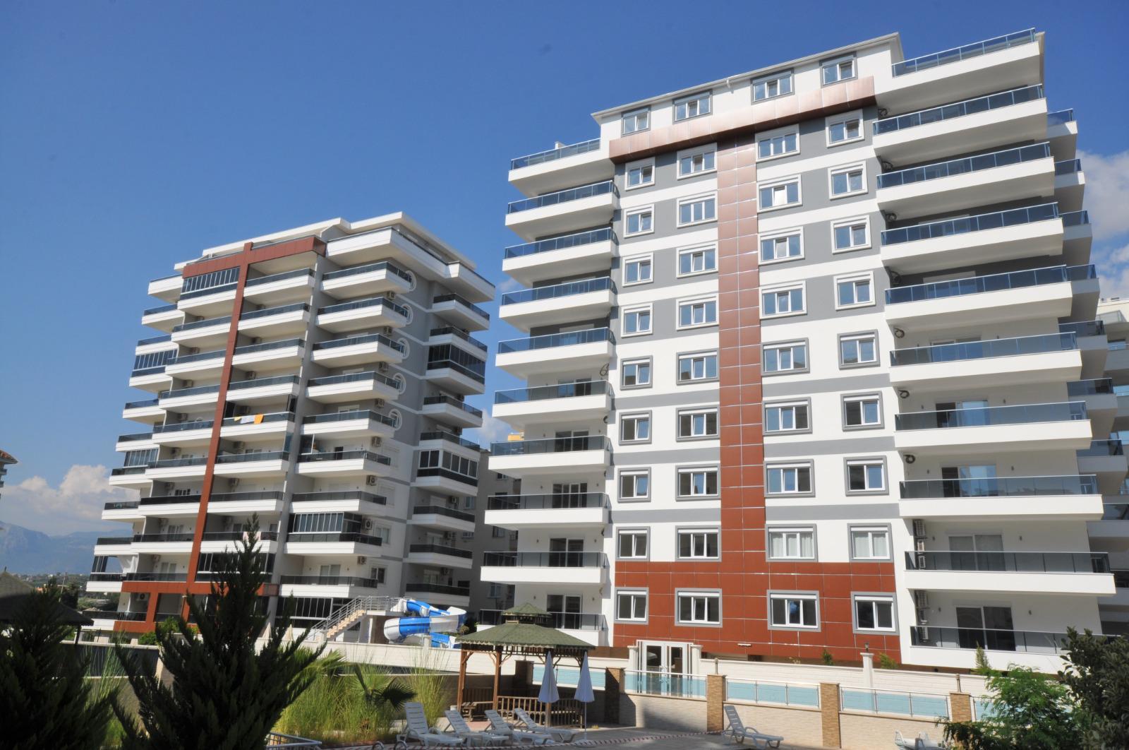 Квартира 1+1 в жилом комплексе района Махмутлар - Фото 1