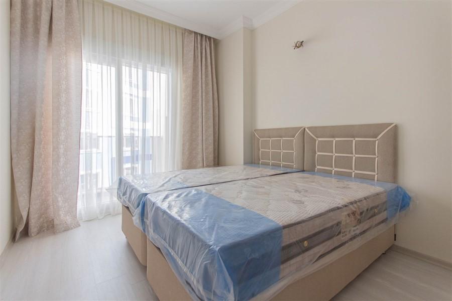 Двухкомнатная квартира с мебелью в районе Махмутлар - Фото 11