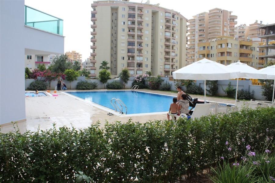 Меблированные апартаменты 1+1 в районе Махмутлар - Фото 2