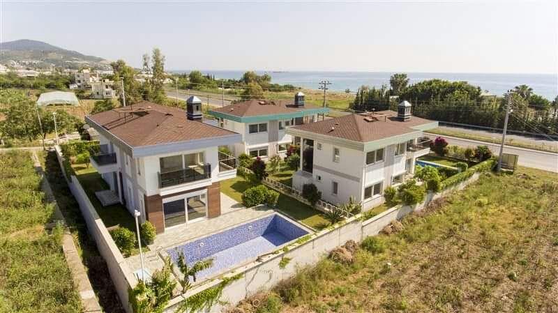 Двухэтажная вилла 4+1 с бассейном на берегу средиземного моря - Фото 1