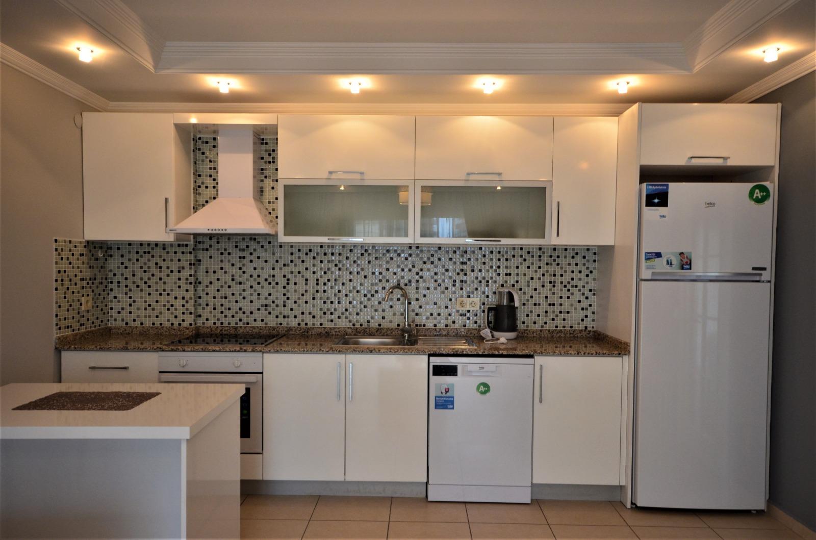 Двухкомнатная квартира с мебелью и бытовой техникой в районе Тосмур - Фото 9