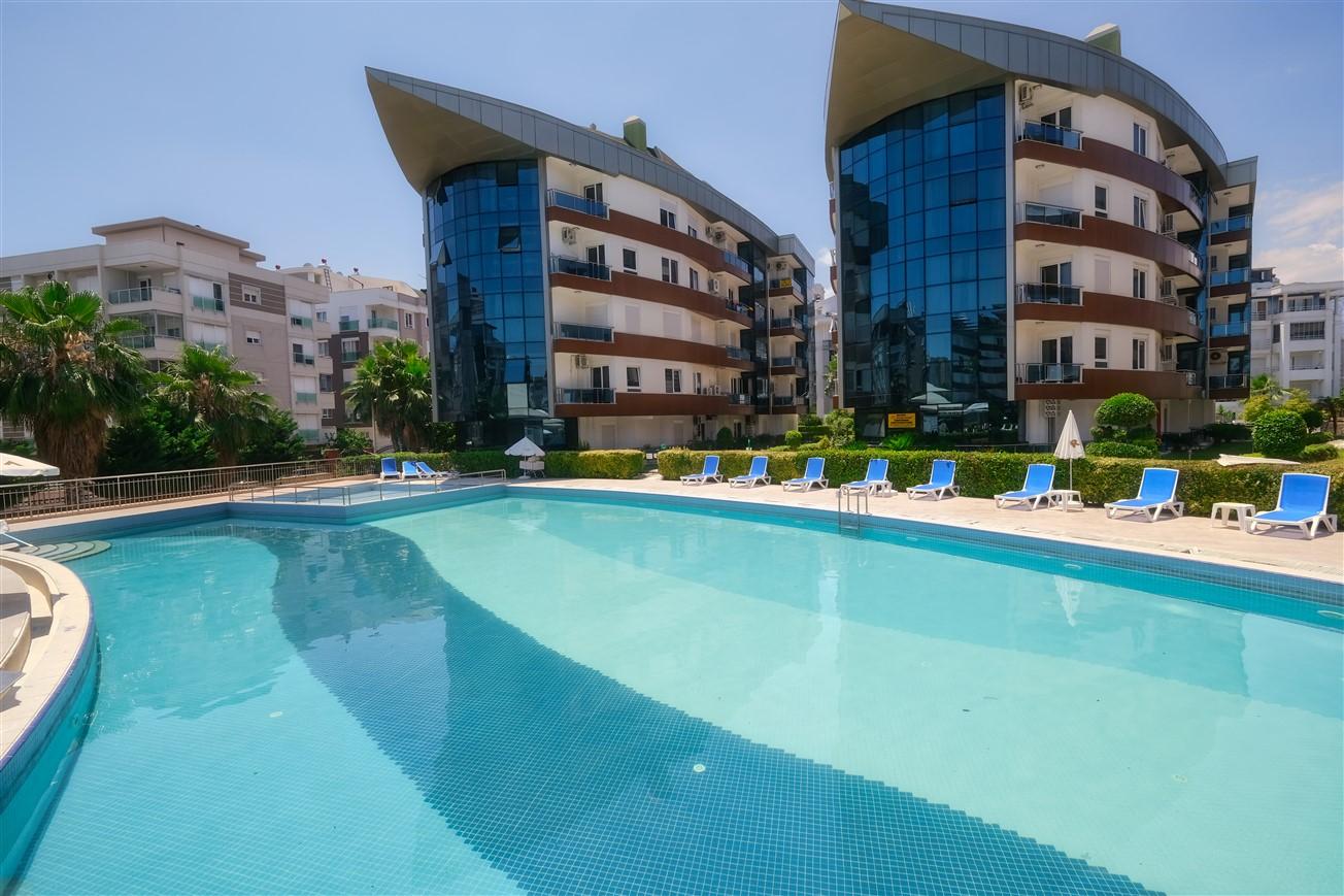 Двухкомнатная квартира с мебелью в элитном комплексе района Коньяалты - Фото 1