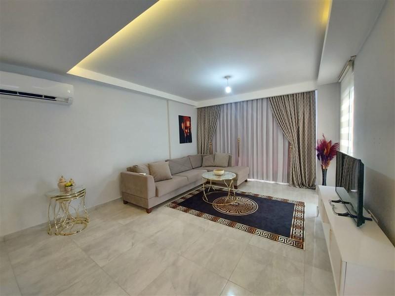 Меблированные апартаменты 1+1 в районе Махмутлар - Фото 8