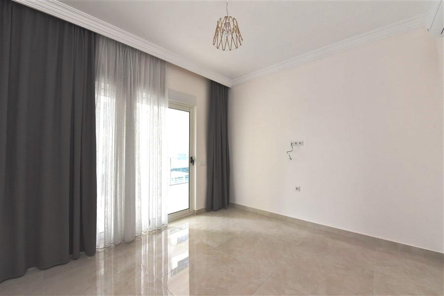 Квартира планировки 2+1 в Махмутларе - Фото 25