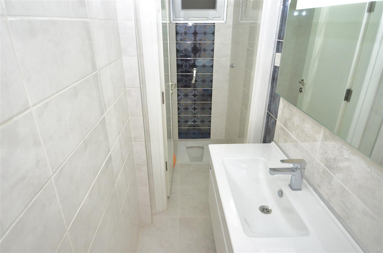 Четырёхкомнатная квартира с отдельной кухней в центральном районе Антальи - Фото 8