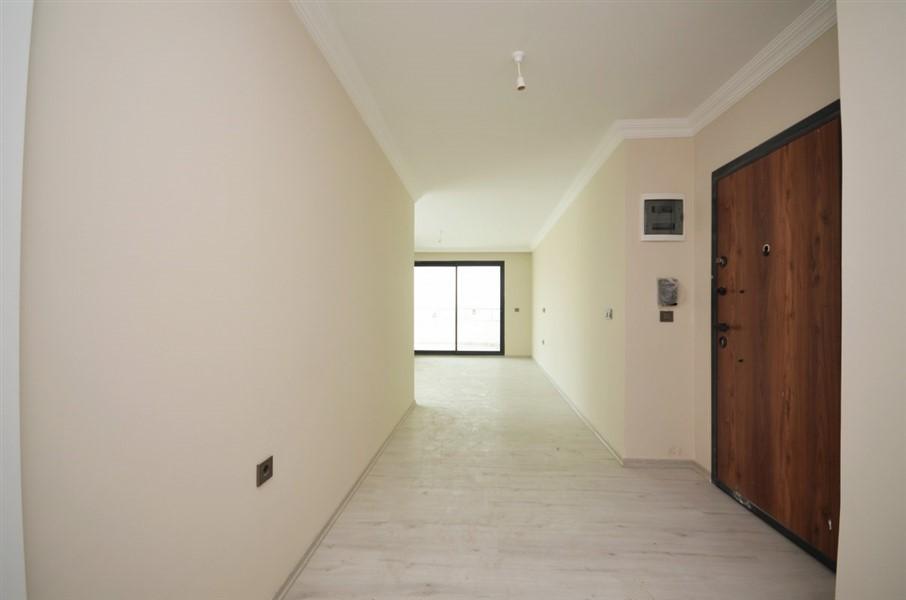 Апартаменты 2+1 в центре района Махмутлар - Фото 1