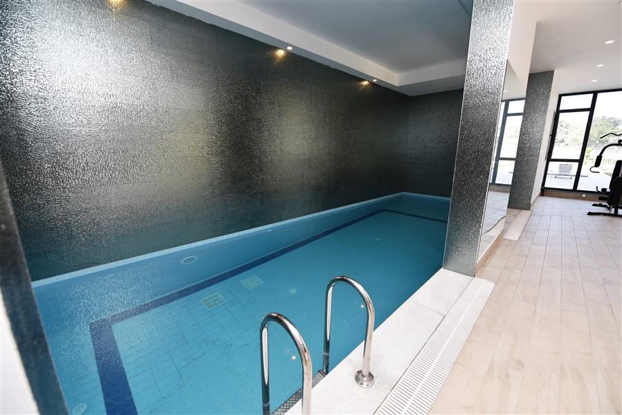 Недвижимость в новом комплексе Махмутлар - Фото 1