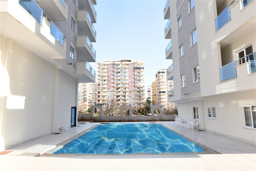 Новая трёхкомнатная квартира в районе Махмутлар - Фото 1