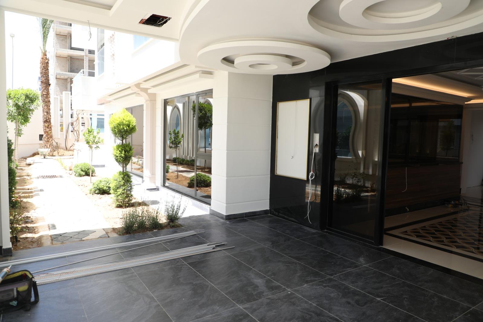 Апартаменты 1+1 в новом комплексе Махмутлар - Фото 11