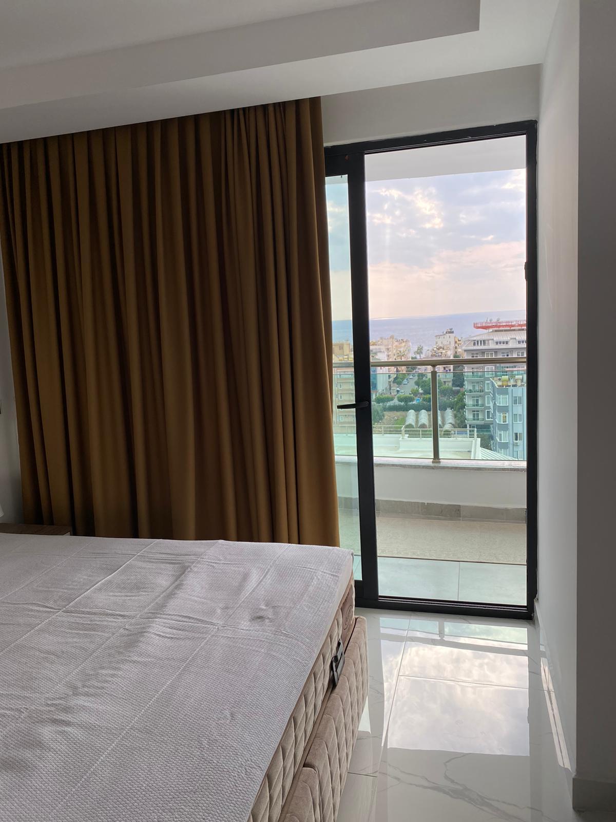 Меблированные апартаменты 1+1 в Махмутларе - Фото 19
