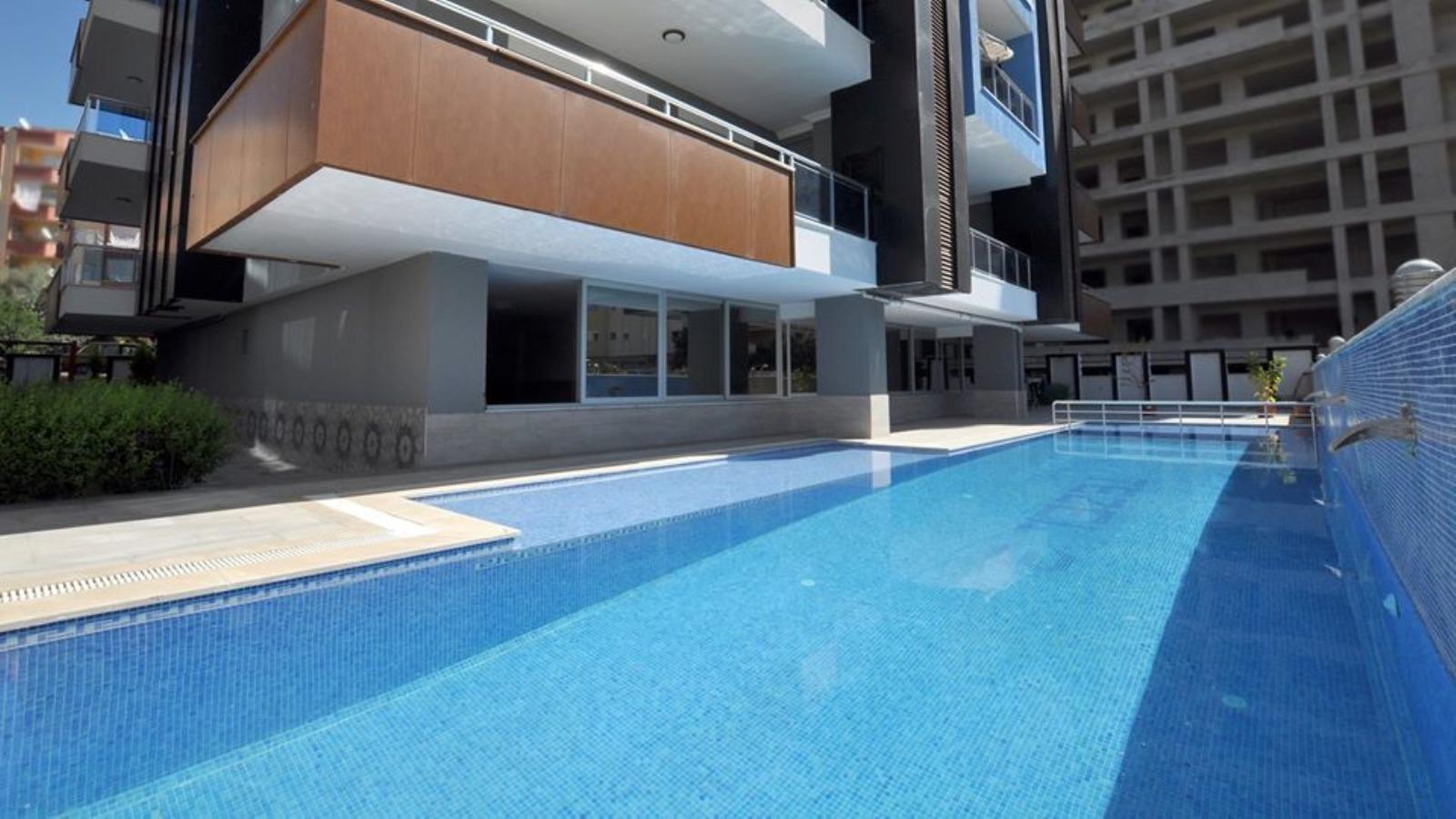 Меблированные апартаменты 1+1 в  Махмутлара - Фото 18