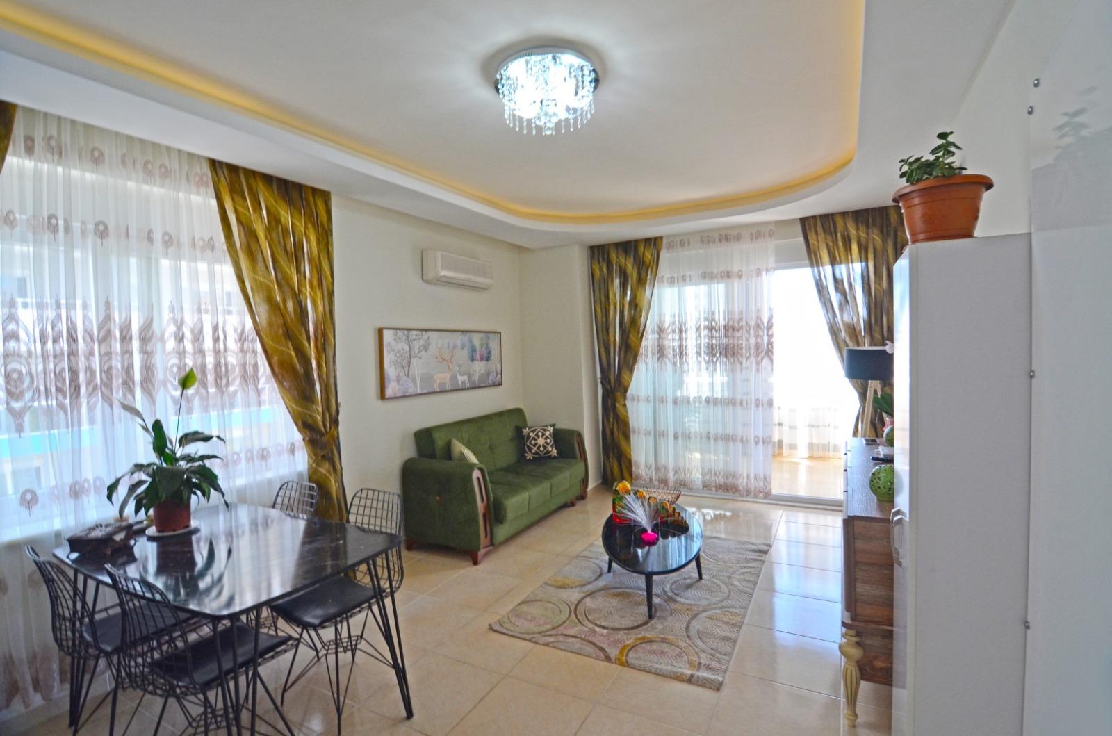 Меблированные апартаменты 1+1 в  Махмутлара - Фото 19