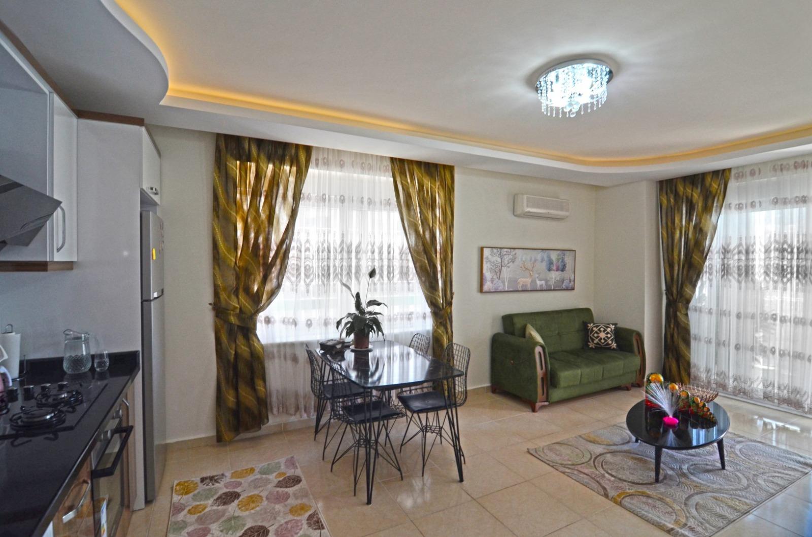 Меблированные апартаменты 1+1 в  Махмутлара - Фото 23