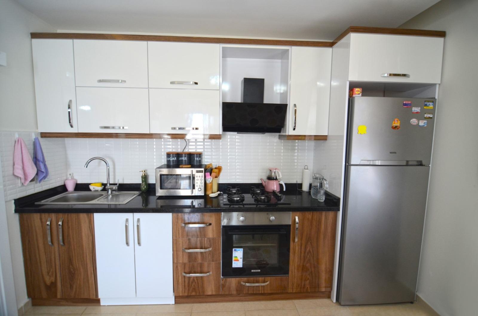 Меблированные апартаменты 1+1 в  Махмутлара - Фото 4