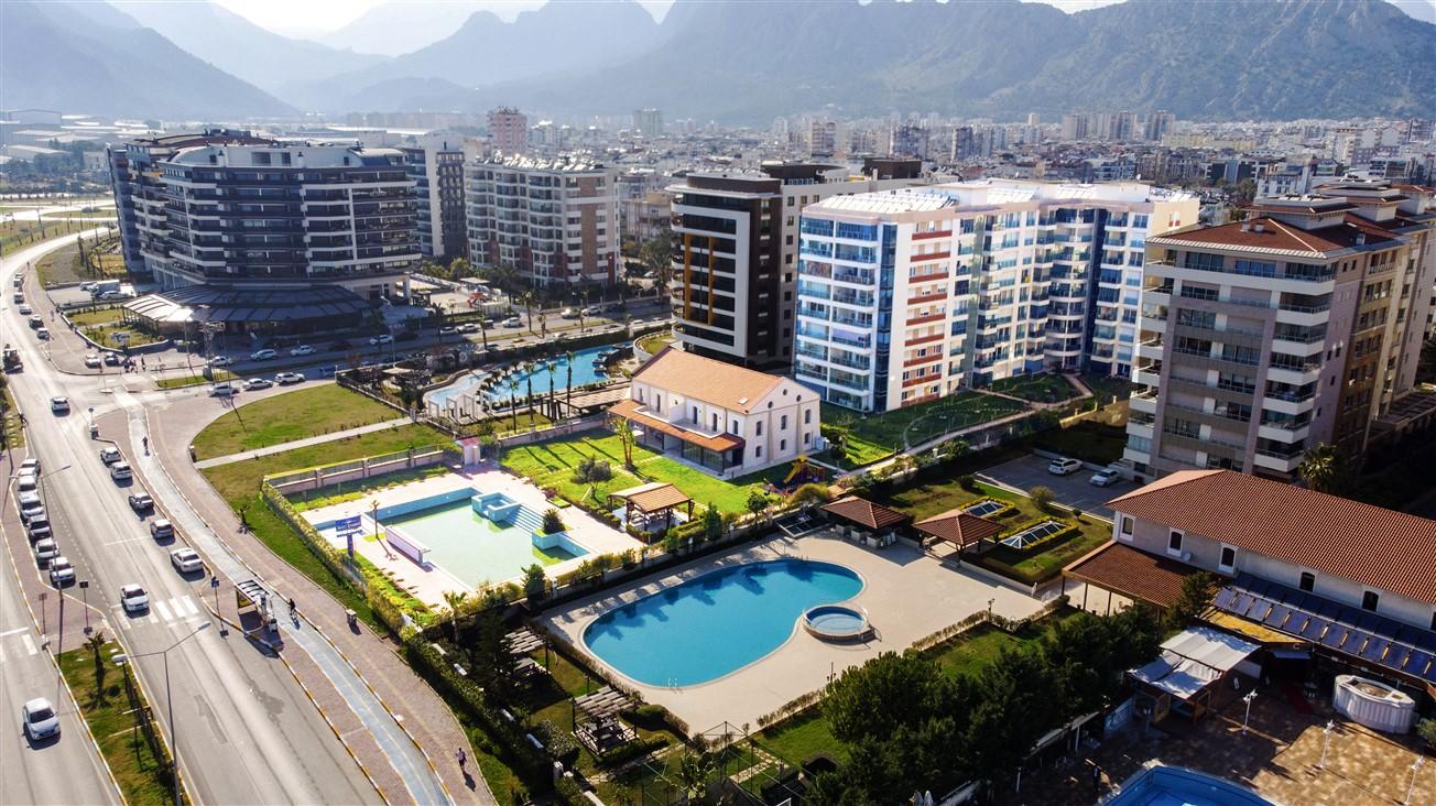 Просторная четырехкомнатная квартира у моря в микрорайоне Лиман- Анталья - Фото 1