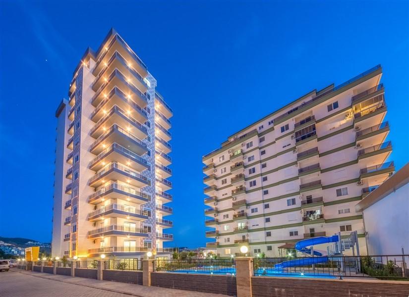 Двухкомнатная квартира в современном комплексе района Махмутлар