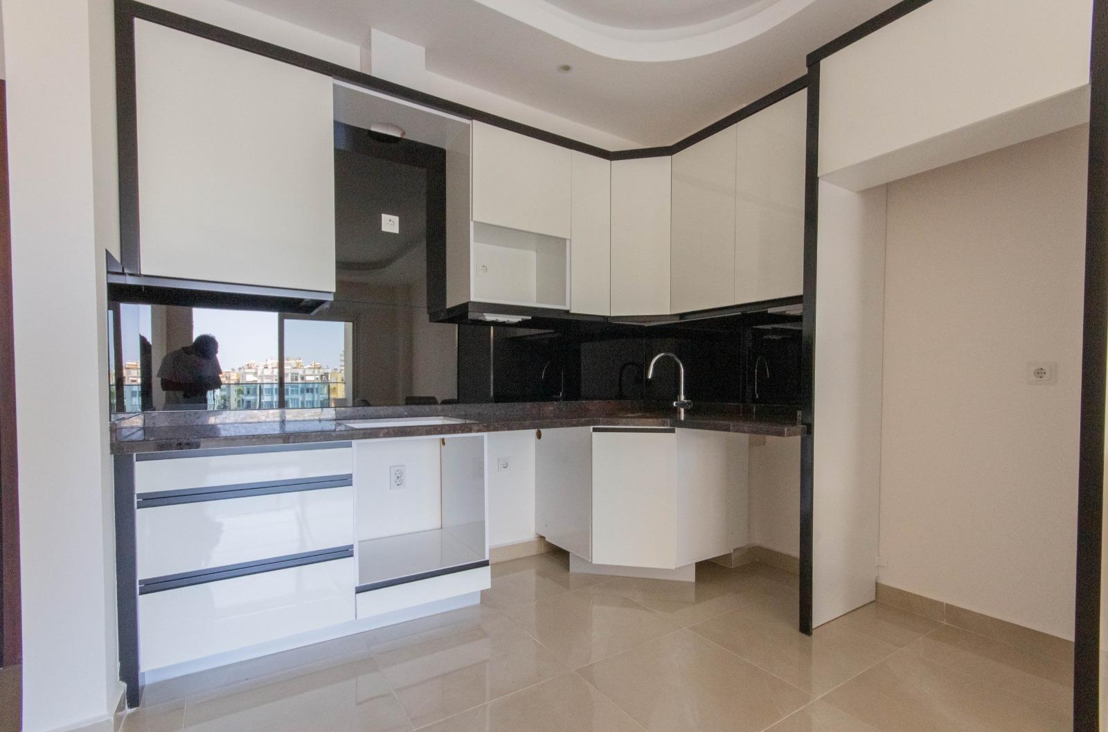 Двухкомнатная квартира в районе Махмутлар - Фото 18