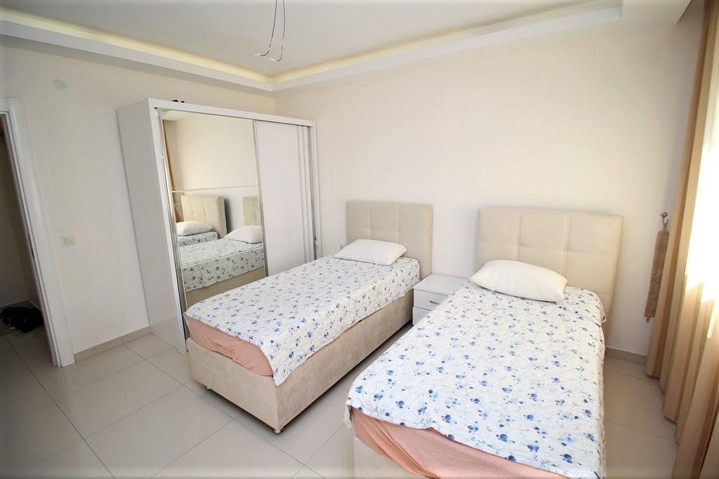 Двухкомнатная квартира в районе Махмутлар - Фото 19