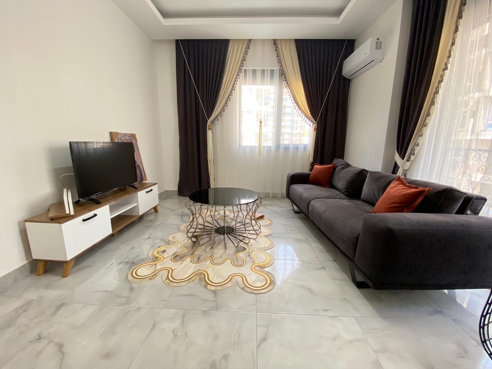 Двухкомнатная квартира в районе Махмутлар. - Фото 8