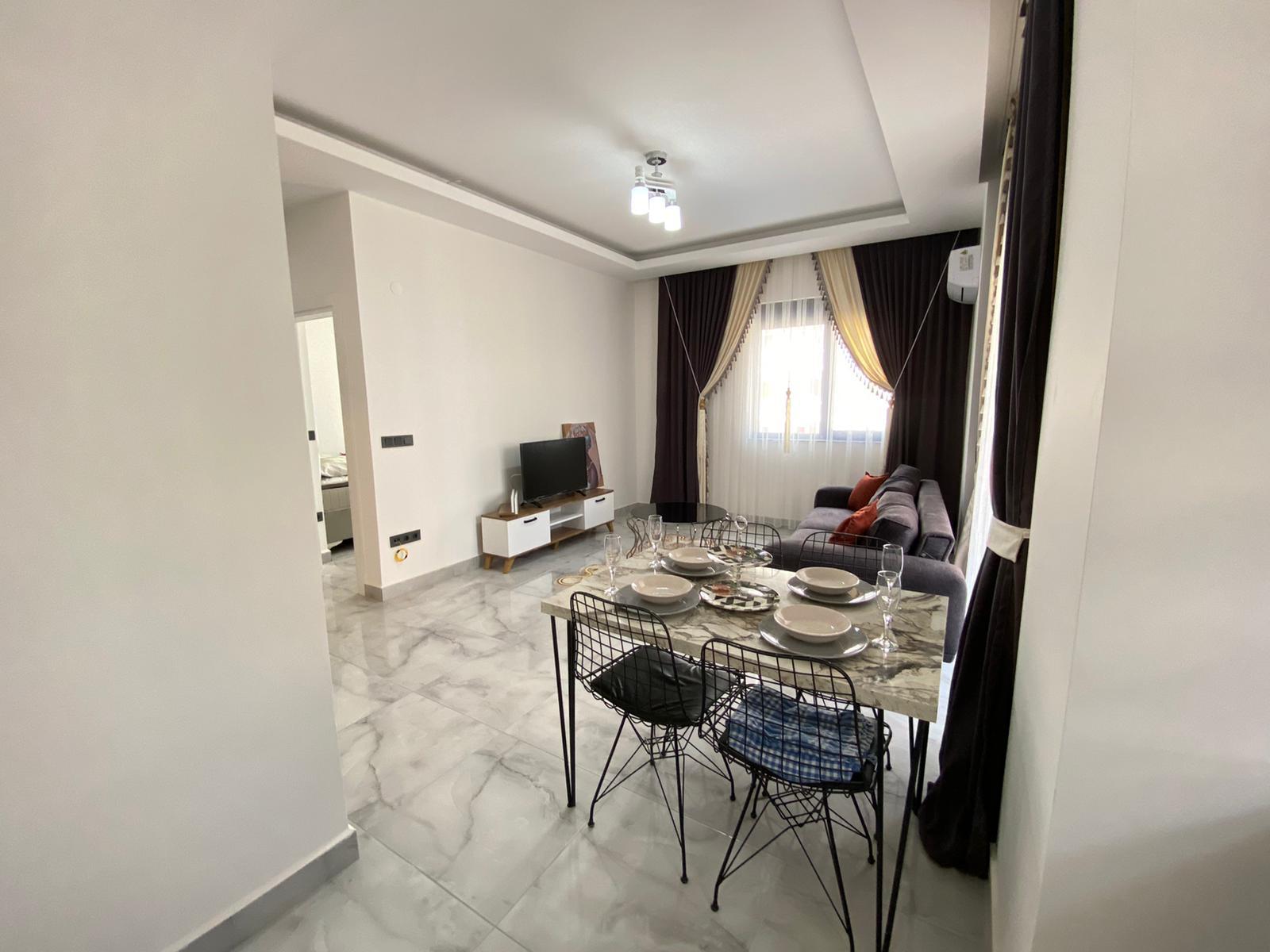Двухкомнатная квартира в районе Махмутлар. - Фото 10
