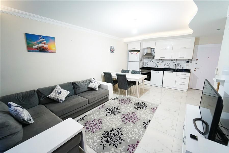 Двухкомнатная квартира с мебелью в центре района Махмутлар. - Фото 11