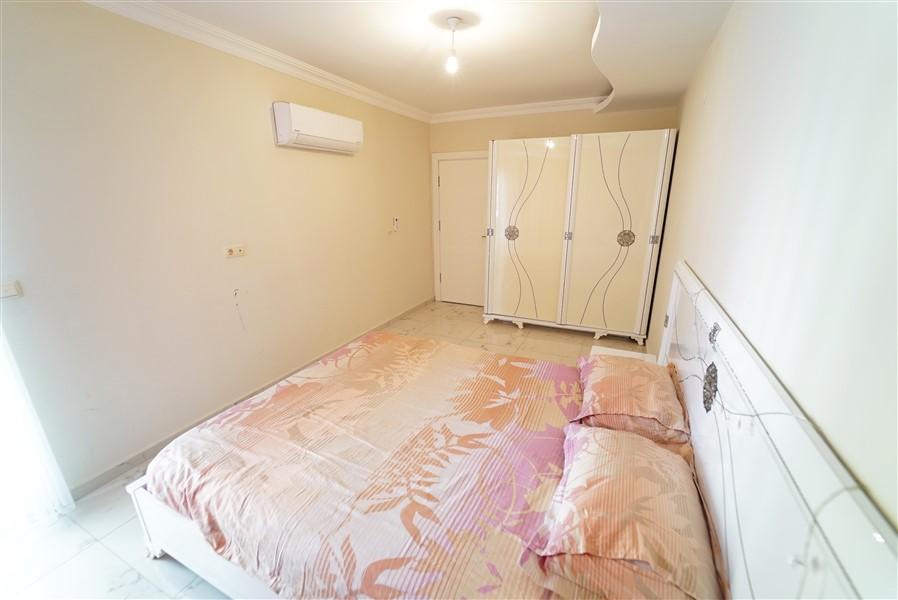 Двухкомнатная квартира с мебелью в центре района Махмутлар. - Фото 17