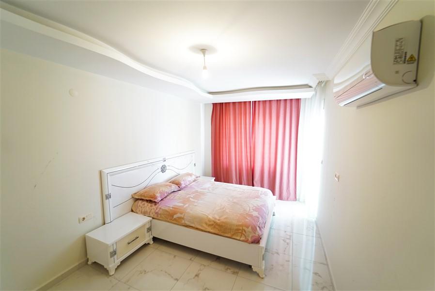 Двухкомнатная квартира с мебелью в центре района Махмутлар. - Фото 15