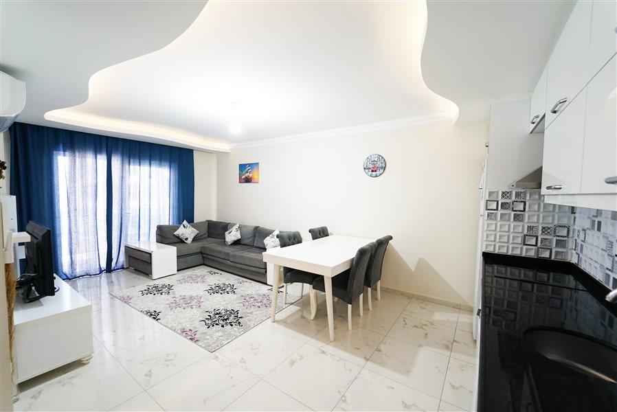 Двухкомнатная квартира с мебелью в центре района Махмутлар. - Фото 8
