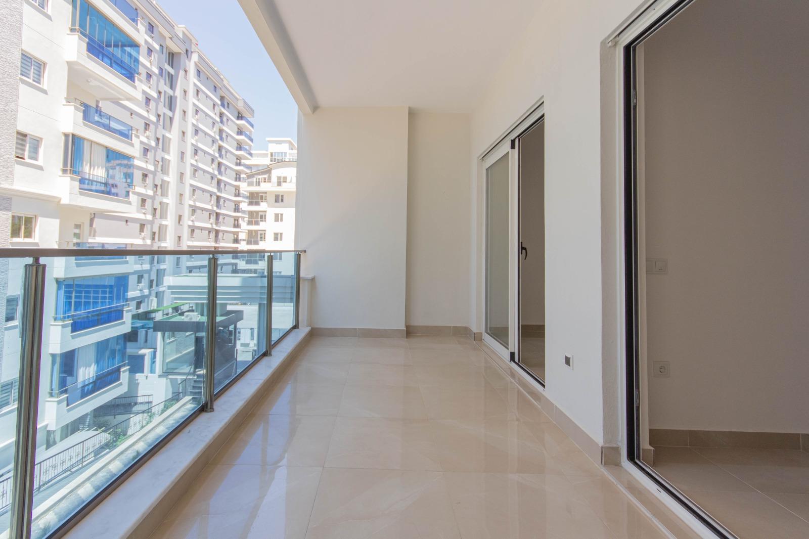 Двухкомнатная квартира в районе Махмутлар - Фото 24