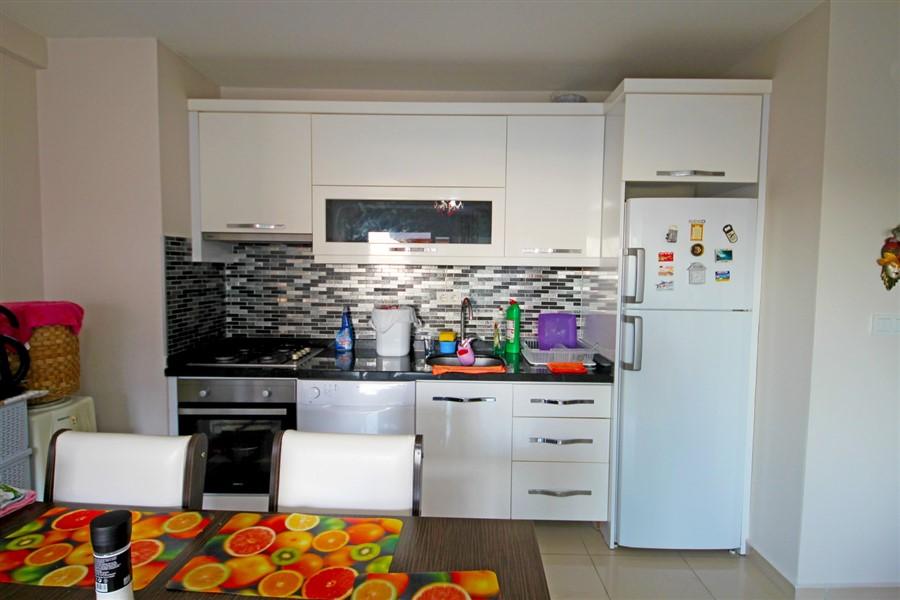 Меблированная квартира 1+1 в центре района Махмутлар - Фото 11