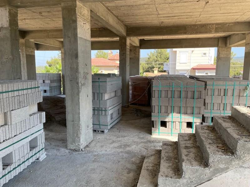 Квартиры в жилом комплексе на этапе строительства в посёлке Авсаллар. - Фото 16