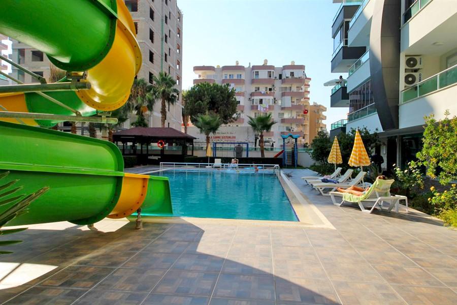 Меблированная квартира 1+1 в центре района Махмутлар - Фото 3