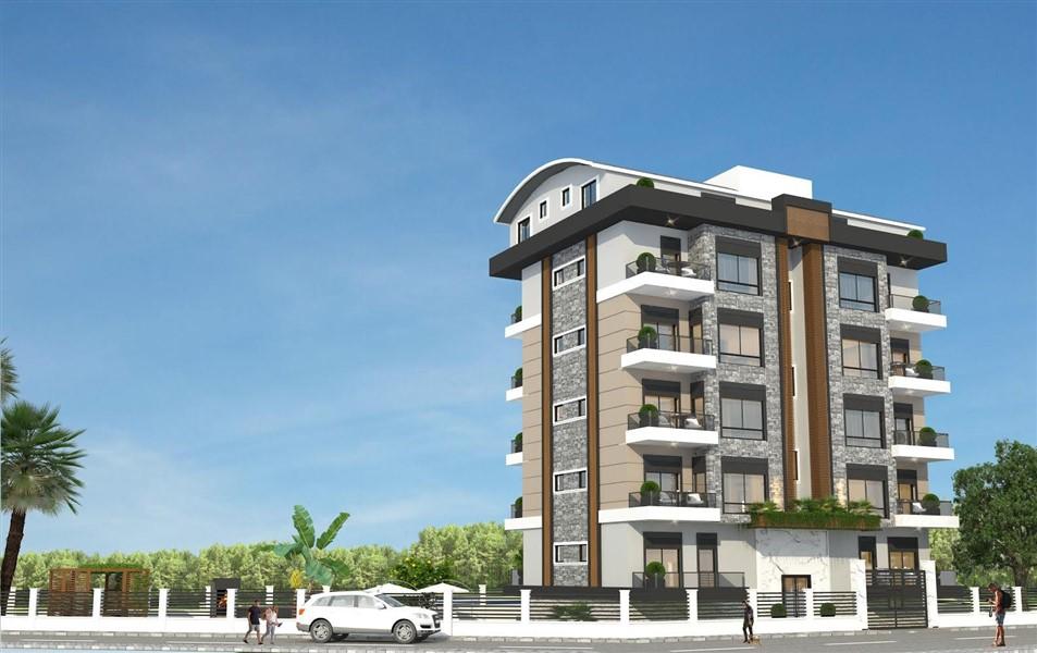 Квартиры в жилом комплексе на этапе строительства в посёлке Авсаллар. - Фото 1