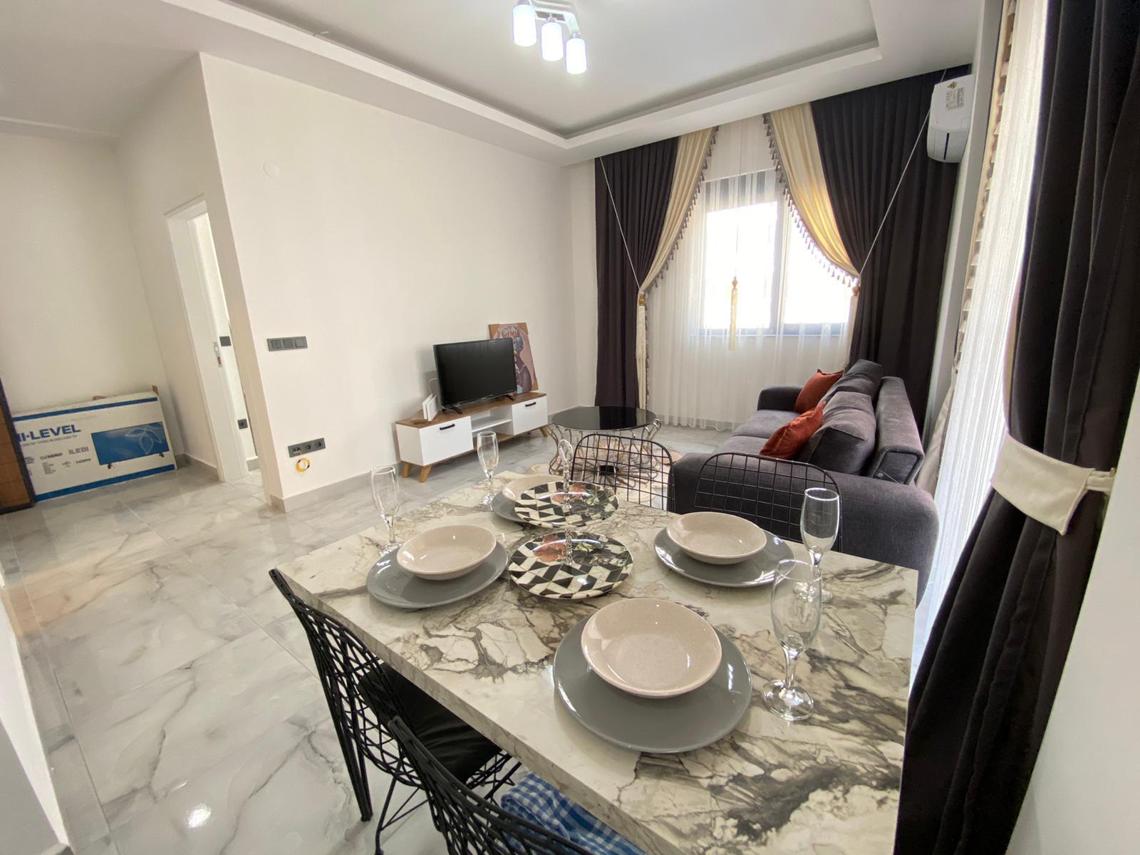 Двухкомнатная квартира в районе Махмутлар. - Фото 11