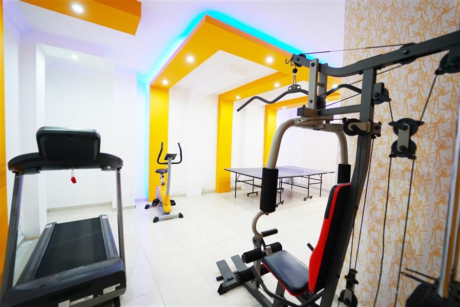 Двухкомнатная квартира с мебелью в центре района Махмутлар. - Фото 3
